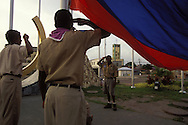 BELIZE / Belize City / Boy Scouts hoisting Belize´s flag at Flags Square...© JOAN COSTA