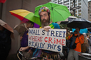 New York City, NY, Sept 29th 2011, participants of the Occupy Wall Street protest movement march in the rain through the streets of the financial center 13 days after their movement began on Sept. 17th.  The protesters set up and encampment in Liberty Square inspired by the Egyptian Tahrir Square uprising .  80 people were arrested on Sept. 24th when the police clashed with the protesters near Union Square Park.
