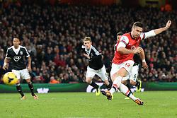 Arsenal's Oliver Giroud scores a goal from a penalty - Photo mandatory by-line: Mitchell Gunn/JMP - Tel: Mobile: 07966 386802 23/11/2013 - SPORT - Football - London - Emirates Stadium - Arsenal v Southampton - Barclays Premier League