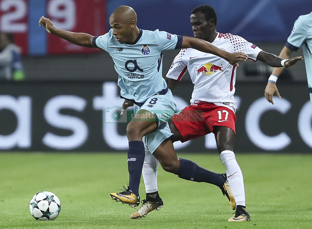 LEIPZIG, Oct. 18, 2017 Leipzig's Bruma (R) vies with Porto's Yacine Brahimi during a match of Group G of 2017-18 Champions League in Leipzig, Germany, on Oct. 17, 2017. Leipzig won 3-2. (Credit Image: © Shan Yuqi/Xinhua via ZUMA Wire)
