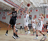 Linn-Mar's Jenna Eells (30) puts up a shot over Waterloo West's Abby Coselman (31) during their game at Linn-Mar High School in Marion on Tuesday January 5, 2010. Linn-Mar defeated Waterloo West 56-32. (Stephen Mally/Freelance)