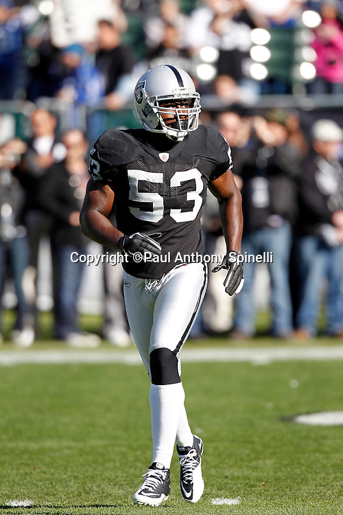 Oakland Raiders linebacker Thomas Howard (53) makes a move during the NFL week 16 football game against the Indianapolis Colts on Sunday, December 26, 2010 in Oakland, California. The Colts won the game 31-26. (©Paul Anthony Spinelli)