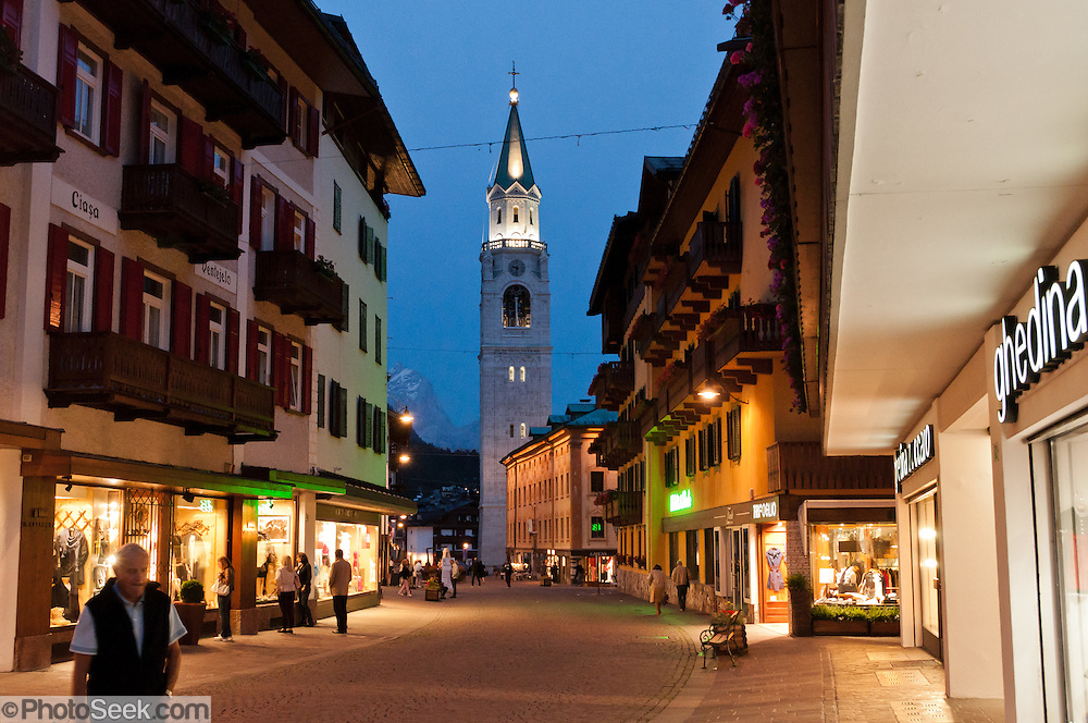 """The mountain town of Cortina d'Ampezzo (Ladin: Anpëz, German: Hayden, at 1224 meters / 4016 feet elevation) is surrounded by the Dolomites (Dolomiti, a part of the Southern Limestone Alps) at the top of Valle del Boite in the Province of Belluno, Veneto region, northern Italy. This ski resort hosted the 1956 Winter Olympics and motion pictures including: """"The Pink Panther"""" (1963), """"For Your Eyes Only"""" (1981, James Bond stunt sequences); and """"Cliffhanger"""" (1993). Nearby peaks include the highest summit, Tofana di Mezzo (3244 m / 10,643 feet) in Tofane mountain group to the west, Pomagagnon to the north, Cristallo to the northeast, Faloria and Sorapiss to the east, and Becco di Mezzodì, Croda da Lago and Cinque Torri to south. The Dolomites were declared a natural World Heritage Site (2009) by UNESCO."""