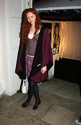 A party hosted by Mario Testino, Bianca Jagger and Kenneth Cole in collaboration with UNFPA and Marie Stopes International to celebrate the publication of Women to Woman: Positively Speaking - a book to raise awareness of women living with HIV/Aids, held at The Orangery, Kensington Palace, London on 2nd December 2004.<br />Picture shows:-Model LILY COLE.<br /><br />NON EXCLUSIVE - WORLD RIGHTS