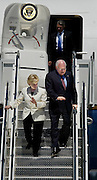 Vice President Dick Cheney and his wife Lynn are blinded by gleaming sunlight reflecting from the metal staircase at Flightcraft. They arrived on Air Force 2 for a fundraiser in Portland to gather campaign dollars for his boss President George W. Bush...