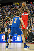 Washington Wizards Thomas Bryant (13) shoots and New York Knicks Luke Kornet (2) during the NBA London Game match between Washington Wizards and New York Knicks at the O2 Arena, London, United Kingdom on 17 January 2019.