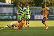 Forest Green Rovers Fabien Robert (26) is tackled by Sutton United's Nicky Bailey, during the Vanarama National League match between Forest Green Rovers and Sutton United at the New Lawn, Forest Green, United Kingdom on 9 August 2016. Photo by Shane Healey.