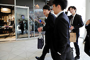 young adult Japanese businessmen on a shopping trip
