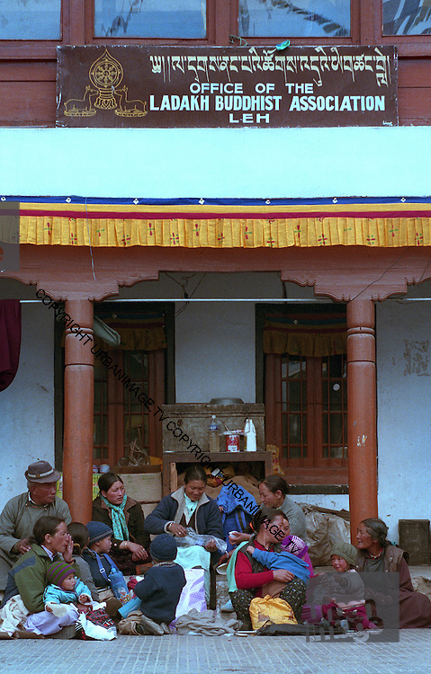 Families wait outside the Buddhist Association office - Ley Ladakh 2006