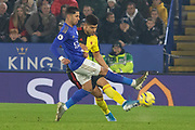 Ricardo Pereira (21) & Adam Masina (11) tangle for the ball during the Premier League match between Leicester City and Watford at the King Power Stadium, Leicester, England on 4 December 2019.