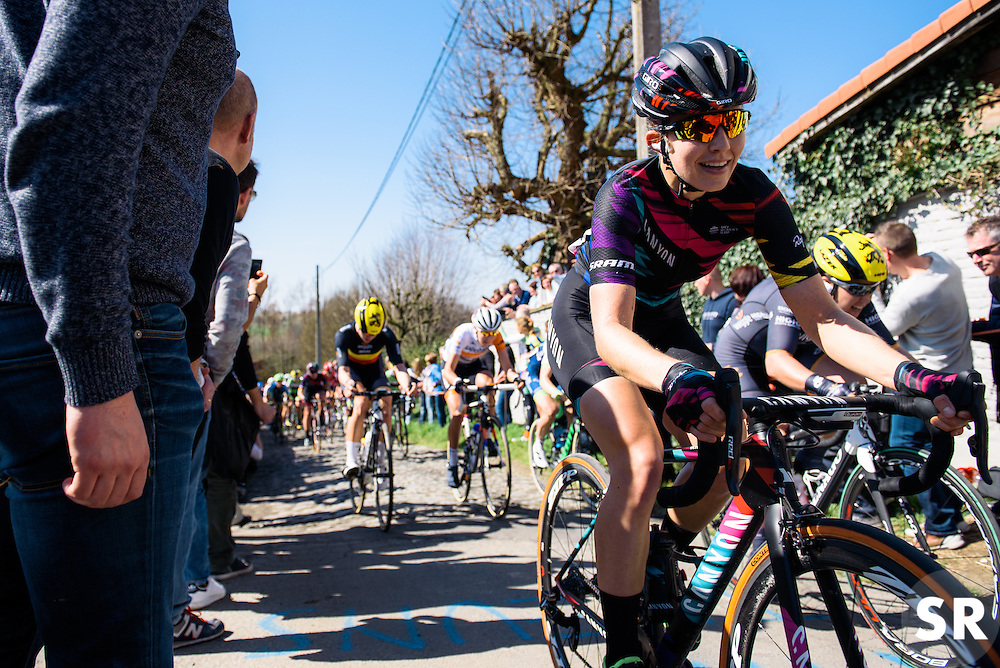 Alexis Ryan reaches the end of the Molenberg cobbles - Women's Ronde van Vlaanderen 2016. A 141km road race starting and finishing in Oudenaarde, Belgium on April 3rd 2016.