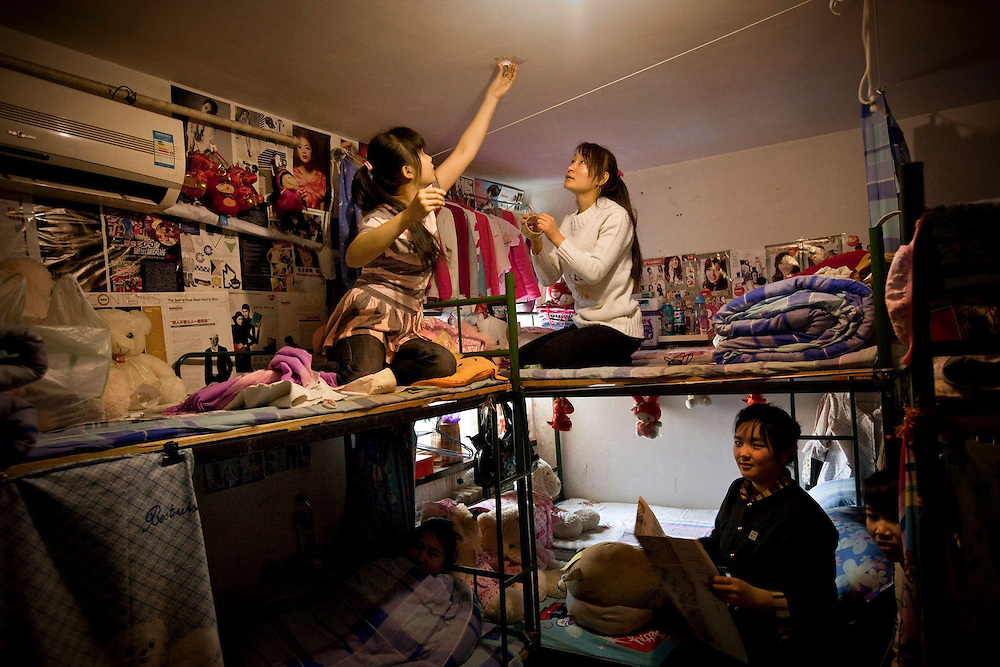 The dorm of the young waitresses, all working at the same restaurant in Beijing, just a few blocks away. Around 200 million workers in China are on the 'tramp', erecting the country's shining metropolises as labourers and running the factories as shift workers.