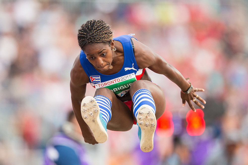 Yorgelis Rodriguez of Cuba competes in the long jump event of the women's heptathlon at the 2015 Pan American Games at CIBC Athletics Stadium in Toronto, Canada, July 25,  2015.  AFP PHOTO/GEOFF ROBINS