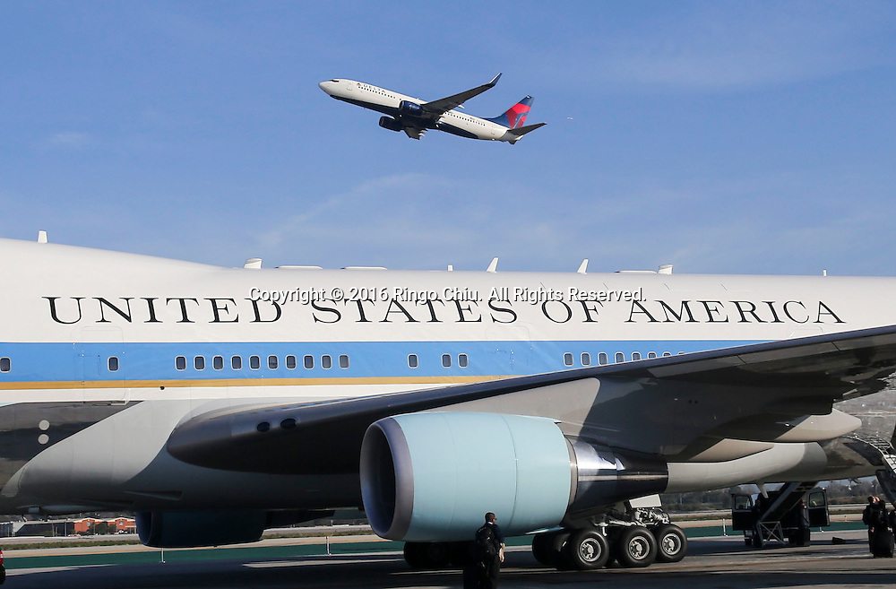 A Delta Airline aircraft flies past Air Force One sitting on the tarmac before President Barack Obama boarding at Los Angeles International Airport in Los Angeles, Friday, Feb 12, 2016.(Photo by Ringo Chiu/PHOTOFORMULA.com)<br /> <br /> Usage Notes: This content is intended for editorial use only. For other uses, additional clearances may be required.