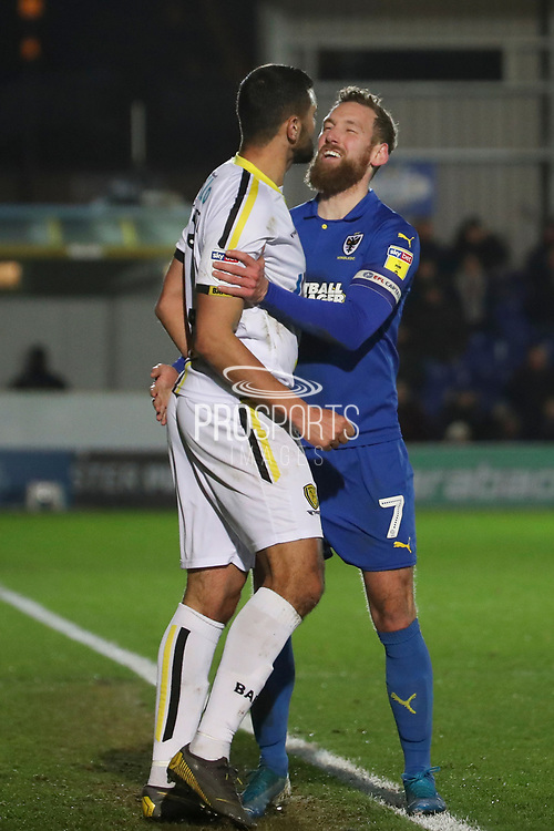 AFC Wimbledon midfielder Scott Wagstaff (7) laughing and holding onto Burton Albion defender Colin Daniel (3) during the EFL Sky Bet League 1 match between AFC Wimbledon and Burton Albion at the Cherry Red Records Stadium, Kingston, England on 28 January 2020.