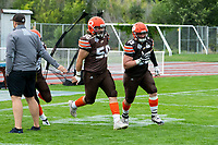KELOWNA, BC - AUGUST 17:   Liam HAMLYN #50 and Aiden HENNESSEY #45 of Okanagan Sun run onto the field against the Westshore Rebels at the Apple Bowl on August 17, 2019 in Kelowna, Canada. (Photo by Marissa Baecker/Shoot the Breeze)