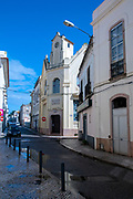 Evangelical Church is hidden between the buildings in downtown Evangelist Church, Figueira da Foz, Portugal