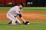 PHOENIX, AZ - MAY 14:  Jake Peavy #22 of the San Francisco Giants slides to field a ground ball hit by the Arizona Diamondbacks during the first inning at Chase Field on May 14, 2016 in Phoenix, Arizona.  (Photo by Jennifer Stewart/Getty Images)