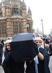 Lawyers and Barristers carry a coffin containing 'justice' during their demonstration to 'Save Legal Aid' outside Westminster, London, UK, May 22, 2013. Photo by Max Nash / i-Images