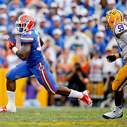 Oct 12, 2013; Baton Rouge, LA, USA; Florida Gators running back Mack Brown (33) runs against the LSU Tigers during the second half of a game at Tiger Stadium. LSU defeated Florida 17-6. Mandatory Credit: Derick E. Hingle-USA TODAY Sports