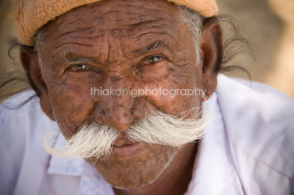 Portrait of camel driver with large white mustache, Jaiselmer, India