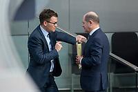 21 MAR 2019, BERLIN/GERMANY:<br /> Carsten Schneider (L), SPD, 1. Parl. Geschaeftsfuehrer SPD BT-Fraktion, und Olaf Scholz (R), SPD, Bundesfinanzminister, im Gespraech, Bundestagsdebatte zur Regierungserklaerung der Bundeskanzlerin zum Europaeischen Rat, Plenum, Deutscher Bundestag<br /> IMAGE: 20190321-01-111<br /> KEYWORDS: Gespräch