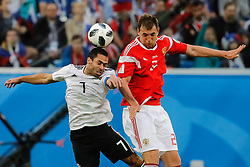 June 19, 2018 - Saint Petersburg, Russia - Artem Dzyuba (R) of Russia national team and Ahmed Fathi of Egypt national team vie for a header during the 2018 FIFA World Cup Russia group A match between Russia and Egypt on June 19, 2018 at Saint Petersburg Stadium in Saint Petersburg, Russia. (Credit Image: © Mike Kireev/NurPhoto via ZUMA Press)