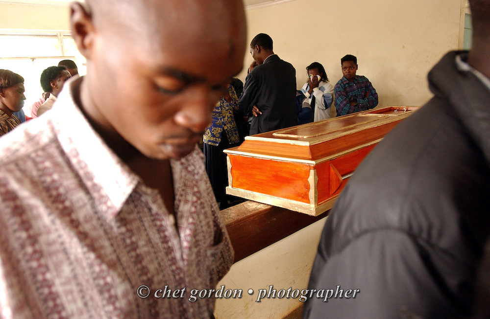 Mourners crowd into the chapel on the grounds of Kenyatta National Hospital in Nairobi, Kenya during funeral services on Saturday, November 2, 2002. The small chapel is the first stop for formal ceremonies, continuing throughout the day, after relatives have retrieved the remains of their deceased loved ones from the morgue of Kenya's largest hospital.