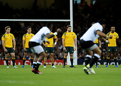 Australia players observe the Fiji Haka  - Mandatory byline: Joe Meredith/JMP - 07966386802 - 23/09/2015 - Rugby Union, World Cup - Millenium Stadium -Cardiff,Wales - Australia v Fiji - Rugby World Cup 2015 - Pool A