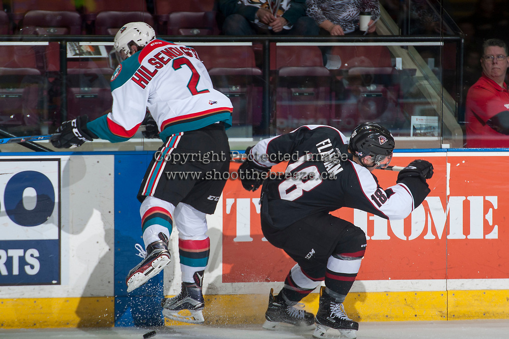 KELOWNA, CANADA - MARCH 10: James Hilsendager #2 of the Kelowna Rockets checks Jack Flaman #18 of the Vancouver Giants on March 10, 2017 at Prospera Place in Kelowna, British Columbia, Canada.  (Photo by Marissa Baecker/Shoot the Breeze)  *** Local Caption ***