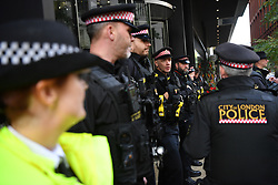 © Licensed to London News Pictures. 16/10/2019. London, UK.City of London police attempt to stop Extinction Rebellion activists blocking the entrance to Google UK headquarters in Kings Cross London, demanding accountability from the Internet giant when representing climate change on their Youtube platform. Photo credit: Guilhem Baker/LNP