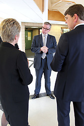 ©Licensed to London News Pictures. 04/04/2014<br /> Brooke Weston Academy, Corby, Northamptonshire. Secretary of State for Education Michael Gove MP visiting Brooke Weston Academy in Corby as part of a fact finding tour of free schools. Pictured, Michael Gove MP with Academy Principal Trish Stringer and CEO of Brooke Weston Trust, Dr Andrew Campbell<br /> Photo credit: Steven Prouse/ LNP