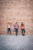 Climbers Inge Perkins, Sam Elias, and Alli Rainey hanging downtown Lander, Wyoming.