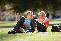 Middle-aged couple reclining in park surface view