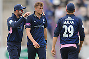 Tom Helm of Middlesex is congratulated on taking his 5th wicket during the Royal London One Day Cup match between Hampshire County Cricket Club and Middlesex County Cricket Club at the Ageas Bowl, Southampton, United Kingdom on 23 April 2019.