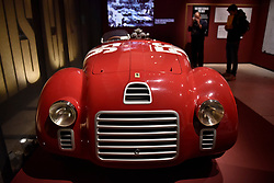"© Licensed to London News Pictures. 14/11/2017. London, UK.  A replica of a Ferrari 125 S, 1947.  Preview of ""Ferrari: Under the Skin"", an exhibition at the Design Museum to mark the 70th anniversary of Ferrari.  Over GBP140m worth of Ferraris are on display from private collections including Michael Schumacher's 2000 F1 winning car.  The exhibition runs 15 November to 15 April 2018.  Photo credit: Stephen Chung/LNP"