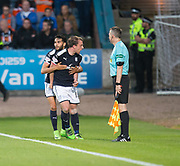August 9th 2017, Dens Park, Dundee, Scotland; Scottish League Cup Second Round; Dundee versus Dundee United; Dundee's Paul McGowan is congratulated after scoring by Faissal El Bakhtaoui after scoring the winning goal as Dundee beat Dundee United 2-1 in the Dundee derby
