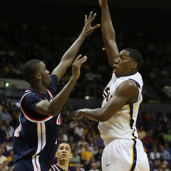 14 February 2009 LSU forward Tasmin Mitchell (1) shoots over Zach Graham (32) of Ole Miss during 73-66 win by the LSU Tigers against SEC rival the Ole Miss Rebels at the Pete Maravich Assembly Center in Baton Rouge, LA.