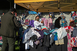 """A """"Joy Market"""" in Jamestown, Stellenbosch, on June 16, 2020. Here people stood in social-distancing lines to pick out free, donated clothing. The market was<br /> organized by a joint Jamestown community taskforce formed in response to families in need during lockdown due to COVID-19. June 16 is Youth Day in South Africa, a public holiday that commemorates the Soweto uprising of 1976. """"We responded to the call during lockdown. Our first priority was the kids,"""" said Arnold Okkers, executive director of Usiko, a Jamestown youth organization. When lockdown started, Usiko began by providing lunch for the 120 kids the organization normally looks after in after-school programs. """"Within a week, it doubled to 250,"""" adds Okkers. The feeding scheme quickly grew to a joint community volunteer effort. The Jamestown volunteer taskforce and supporters have been feeding about 400 people per day here, as many people lost their jobs during lockdown. Okkers says they will be able to scale back the feeding scheme a little bit now, as people have been able to return to work during Level 3 of lockdown. """"More and more people are able to care for themselves,"""" he says. PHOTO: EVA-LOTTA JANSSON"""