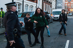 "Mayfair, London, November 28th 2014. A protest against Egypt's leader Al-Sisi descended into moinor scuffles as right wing ""patriots"" from anti-Islamic group Britain First arrived to protest against the presence of Islamist preacher Anjem Choudary, who was recently arrestred as part of an ant-terror operation. Playing patriotic British Music, Britain First accused Muslims of worshiping a ""devil"" and a ""paedophile prophet"". Police had to intervene before hotheads on both sides became violent. PICTURED: Jayda Fransen, Deputy Leader of Britain First is locked in a police van after being arrested as she breaks through a police line."