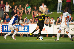 ZUG, SWITZERLAND - Wednesday, July 21, 2010: Liverpool's Philipp Degen in action against Grasshopper Club Zurich during the Reds' first preseason match of the 2010/2011 season at the Herti Stadium. (Pic by David Rawcliffe/Propaganda)