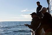 Kapten Nik Ranta hj&auml;lper 87-&aring;rige Harvey Deardoff med att komma i g&aring;ng med fisket.<br /> <br /> Seward, Alaska<br /> <br /> Photographer: Christina Sjogren<br /> <br /> Copyright 2018, All Rights Reserved