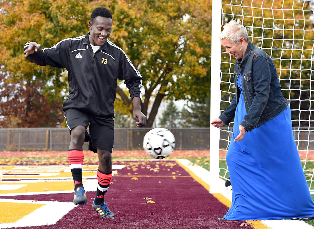 Mara Lavitt--Special to the Hartford Courant<br /> November 7, 2015 <br /> South Windsor varsity soccer player Daniel Eddy does a little agility practice while his mother Barbara watches nearby. Eddy, originally from Haiti, was adopted with his two sisters by Barbara two years ago.