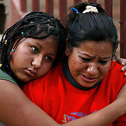 Daniela Mendoza, 17, hugs Leticia Carreon, 34, after a fire burned their apartment at Gala Vista Apartments. Daniela was inside with three other minors, but there were no injuries. Leticia was at work during the blaze on Friday, June 13, 2008, in Houston.
