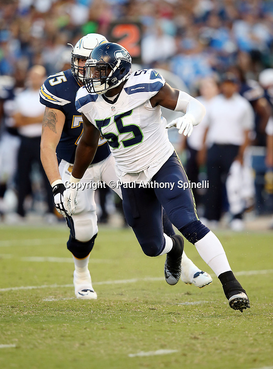 Seattle Seahawks defensive end Frank Clark (55) beats a block by San Diego Chargers guard Jeremiah Sirles (75) during the 2015 NFL preseason football game against the San Diego Chargers on Saturday, Aug. 29, 2015 in San Diego. The Seahawks won the game 16-15. (©Paul Anthony Spinelli)