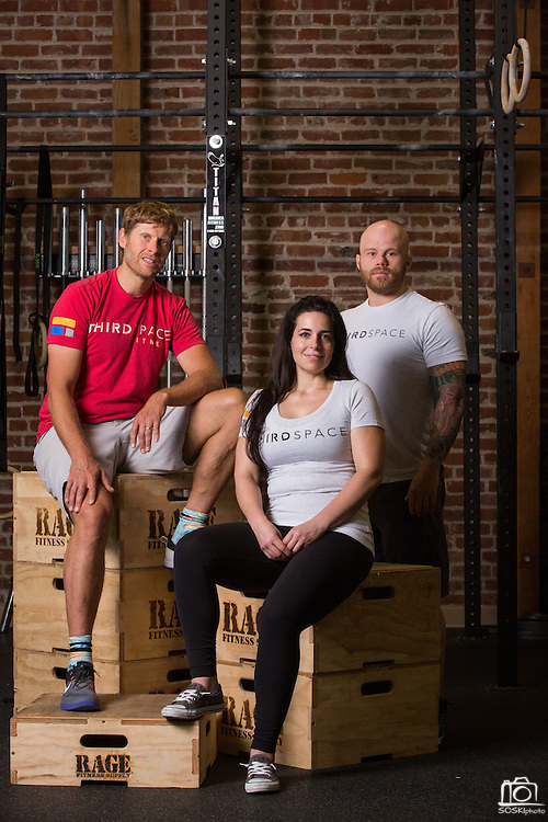 ThirdSpace Fitness co-owners Lance Miller, Danielle Valley, and David Downs, left to right, pose for a portrait at ThirdSpace Fitness in San Jose, California, on September 2, 2015. (Stan Olszewski/SOSKIphoto)