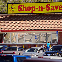 Customers come and go from the Lowe's Shop-n-Save in downtown Gallup Wednesday.