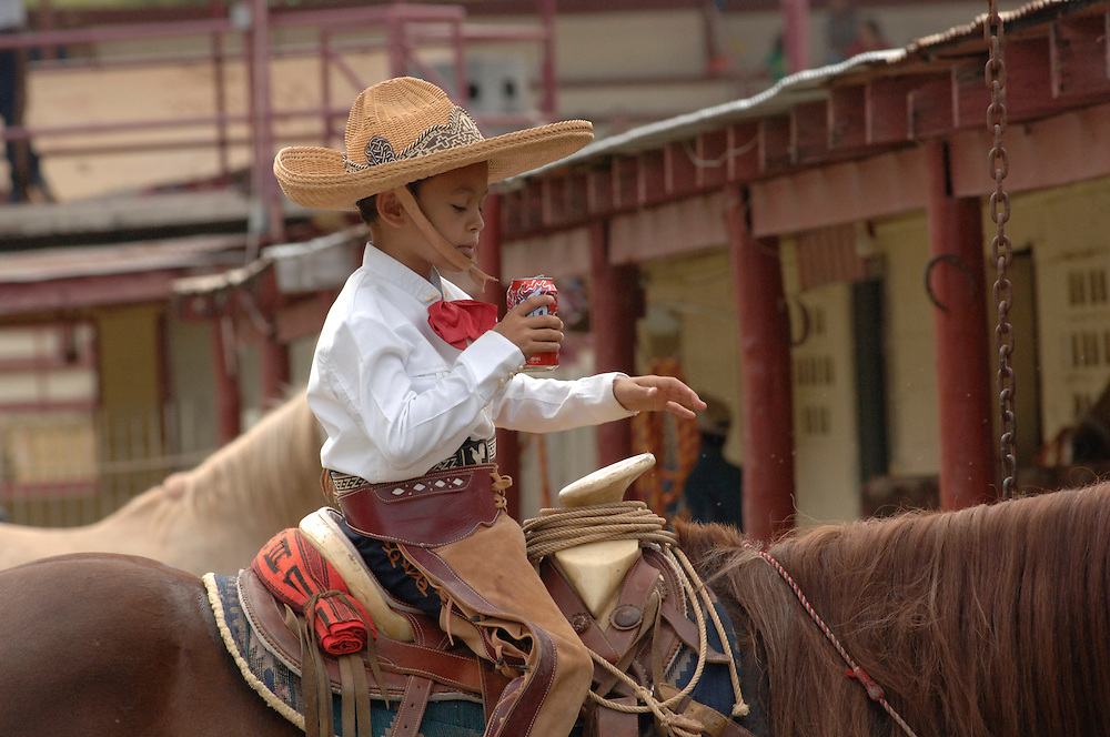 SAN ANTONIO, Texas -- Edmond Rios, III prepares for and competes at a San Antonio Charro Association hosted Charreada on Oct 23th, 2005 at the San Antonio Charro Ranch, 6126 Padre Dr. (Photo by Lance Cheung)