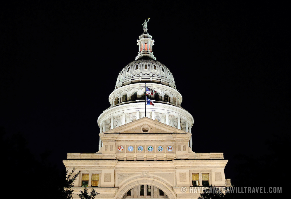 The dome of the Texas State Capitol in Austin at night. Completed in 1888 and in an architectural style of Renaissance Revival, the Texas State Capitol is the largest of the state Capitols. Although smaller in size than the US Capitol in Washington DC, it's dome rises 15 feet higher than the US Capitol Dome. On a high point in Austin's downtown, it has a commanding view over the surround area. Its exterior is of locally source granite.