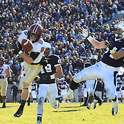 Andrew Berg, (left), Harvard, fails to hold a pass as he is challenged by Robert Ries, Yale,  during the Yale V Harvard, Ivy League Football match at Yale Bowl. Harvard won the game 34-7 giving Harvard a share of the 2013 Ivy League title.  The game was the 130th meeting between Harvard and Yale in the historic rivalry that dates back to 1875. New Haven, Connecticut, USA. 23rd November 2013. Photo Tim Clayton